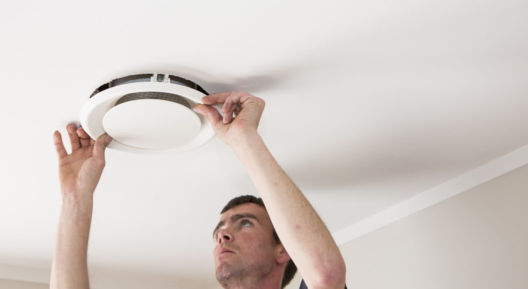 Man installing Unovent's Xgen in ceiling